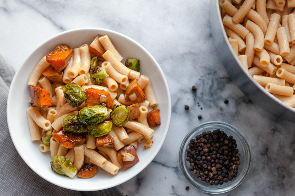 Eat Banza Gluten-Free Pasta with Brussels Sprouts, Honeynut Squash and fresh ground pepper