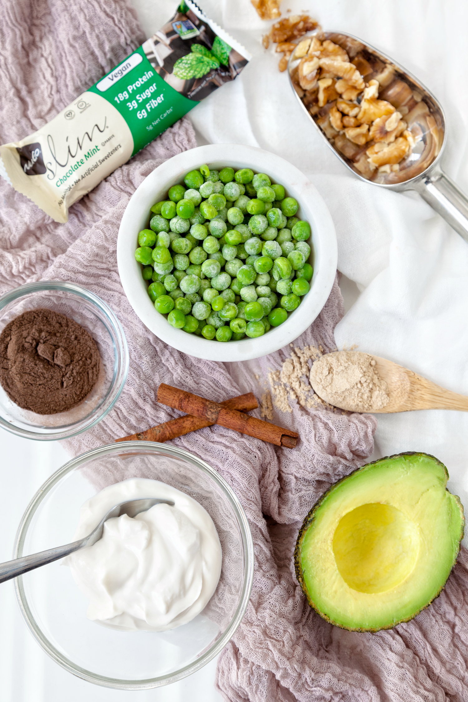 Low-Sugar Smoothie ingredients: Nugo Slim Chocolate Mint, frozen peas, walnuts, avocado, non-dairy yogurt, cinnamon, nutmeg, Navitas organic gelatinized maca, Four Signmatic Chaga, SunWarrior vanilla protein powder.