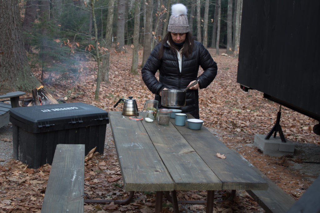 Kerri Axelrod making breakfast at Getaway House in New Hampshire