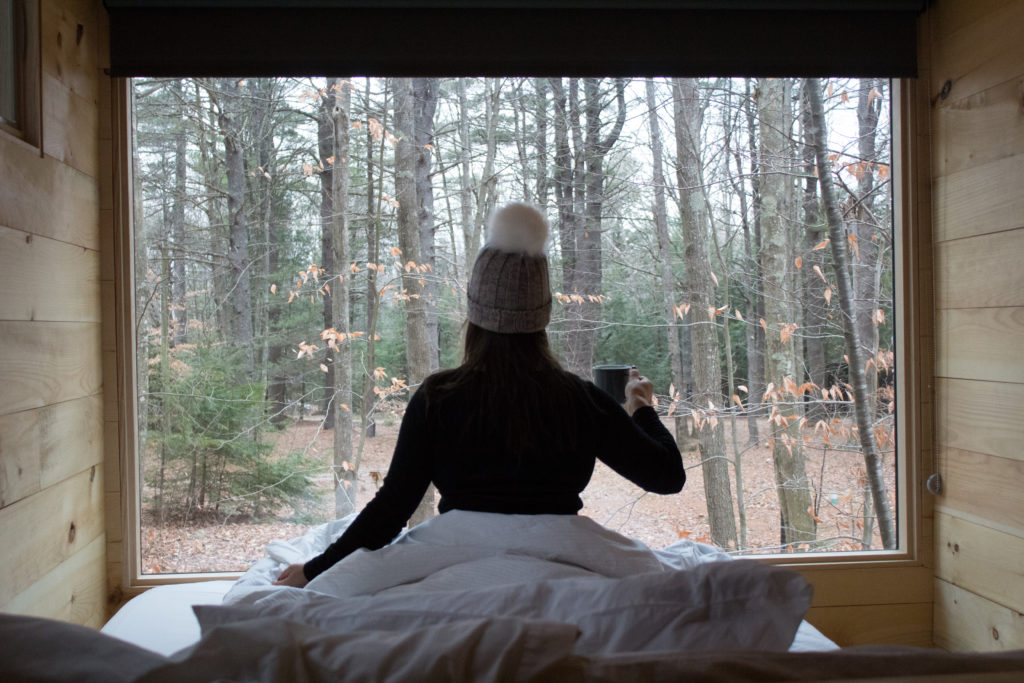 Kerri Axelrod sitting in meditation with Matcha at Getaway House in New Hampshire